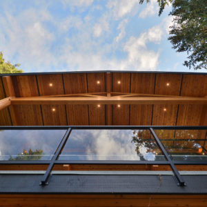 View Exterior Deck Over Hang Roof From Ground - Selma Park Post Beam Residence