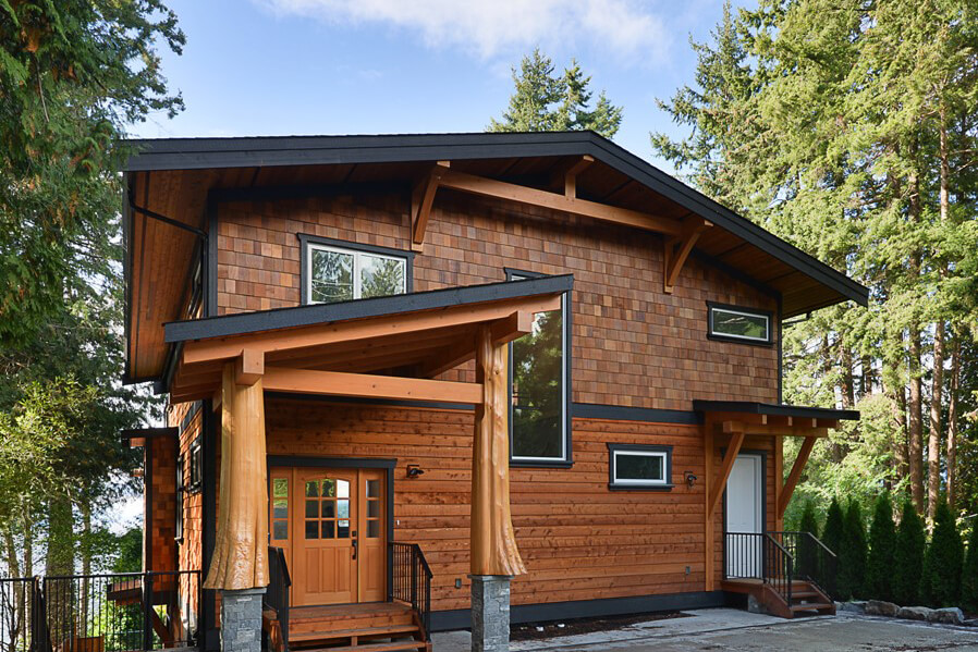 Exterior view of main entrance and guest suite entrance - Selma Park Post Beam residence