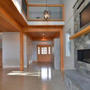 Family Room With Fireplace And View To Entrance And Loft