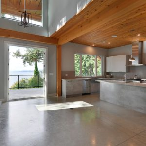 Open Floor Plan Family Room And Kitchen With French Doors Onto Back Deck
