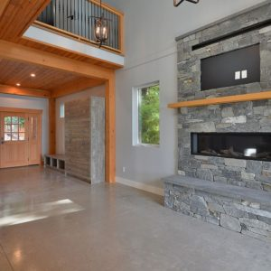 Interior - Stone Fireplace And TV Mount Area Above - Selma Park Post Beam Residence