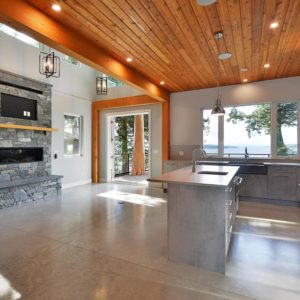 Interior View Of Kitchen And Family Room Open Floor Plan - Selma Park Post Beam Residence